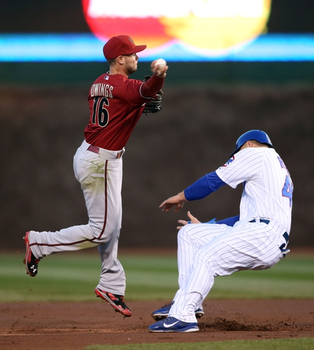 Apr 22, 2014; Chicago, IL, USA; Arizona Diamondbacks shortstop Chris Owings (16) forces out Chicago Cubs first baseman Anthony Rizzo and throws to first base during the first inning at Wrigley Field. Mandatory Credit: Jerry Lai-USA TODAY Sports