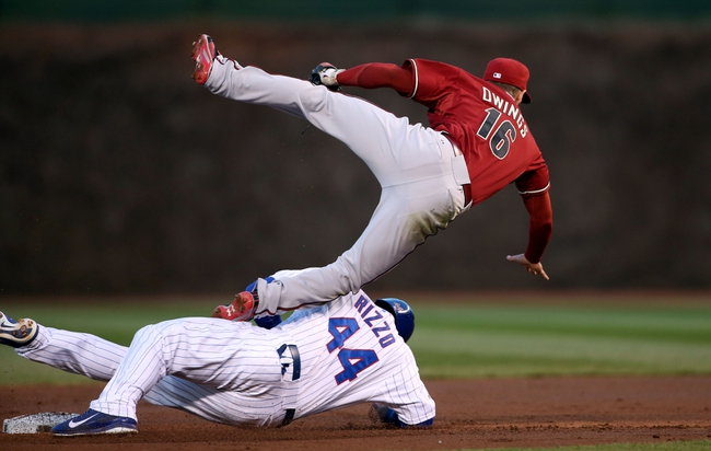 Apr 22, 2014; Chicago, IL, USA; Arizona Diamondbacks shortstop Chris Owings (16) is up ended by Chicago Cubs first baseman Anthony Rizzo (44) during the first inning at Wrigley Field. Mandatory Credit: Jerry Lai-USA TODAY Sports