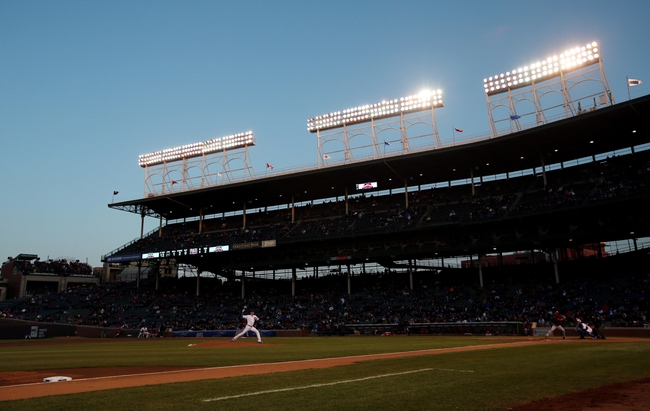 Apr 22, 2014; Chicago, IL, USA; Chicago Cubs starting pitcher Jason Hammel throws a pitch during the second inning against the Arizona Diamondbacks at Wrigley Field. Mandatory Credit: Jerry Lai-USA TODAY Sports