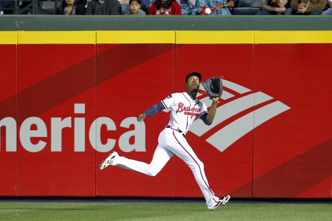 Apr 22, 2014; Atlanta, GA, USA; Atlanta Braves center fielder B.J. Upton (2) catches a fly ball against the Miami Marlins in the sixth inning at Turner Field. Mandatory Credit: Brett Davis-USA TODAY Sports