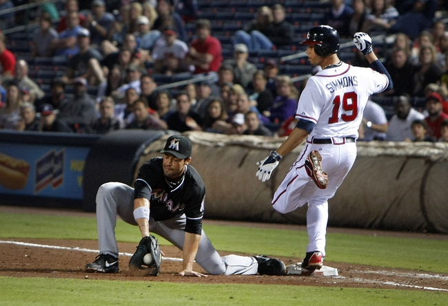 Apr 22, 2014; Atlanta, GA, USA; Atlanta Braves shortstop Andrelton Simmons (19) beats a throw to Miami Marlins first baseman Garrett Jones (46) in the eighth inning at Turner Field. The Marlins defeated the Braves 1-0. Mandatory Credit: Brett Davis-USA TODAY Sports