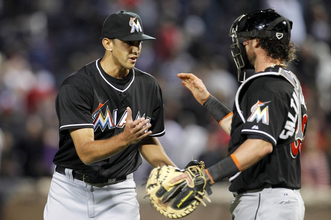 Apr 22, 2014; Atlanta, GA, USA; Miami Marlins relief pitcher Steve Cishek (31) celebrates with catcher Jarrod Saltalamacchia (39) after a win against the Atlanta Braves at Turner Field. The Marlins defeated the Braves 1-0. Mandatory Credit: Brett Davis-USA TODAY Sports
