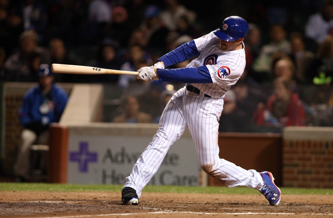 Apr 22, 2014; Chicago, IL, USA; Chicago Cubs outfielder Nate Schierholtz drives in a run with a sacrifice fly during the fifth inning against the Arizona Diamondbacks at Wrigley Field. Mandatory Credit: Jerry Lai-USA TODAY Sports