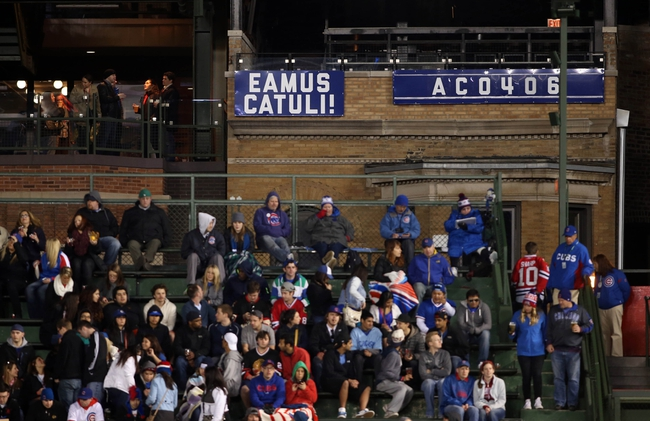 Apr 22, 2014; Chicago, IL, USA; A general view of a banner hanging from a rooftop on Sheffield Avenue behind the bleachers during the fifth inning between the Chicago Cubs and Arizona Diamondbacks at Wrigley Field. Mandatory Credit: Jerry Lai-USA TODAY Sports
