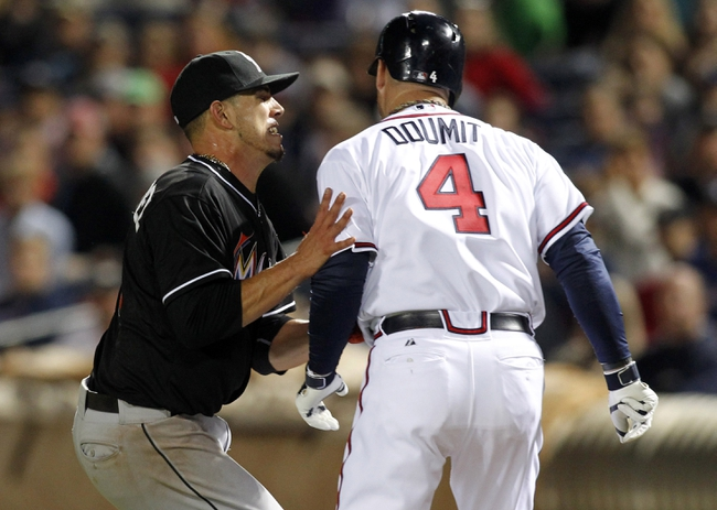 Apr 22, 2014; Atlanta, GA, USA; Miami Marlins starting pitcher Jose Fernandez (16) tags out Atlanta Braves catcher Ryan Doumit (4) in the eighth inning at Turner Field. The Marlins defeated the Braves 1-0. Mandatory Credit: Brett Davis-USA TODAY Sports