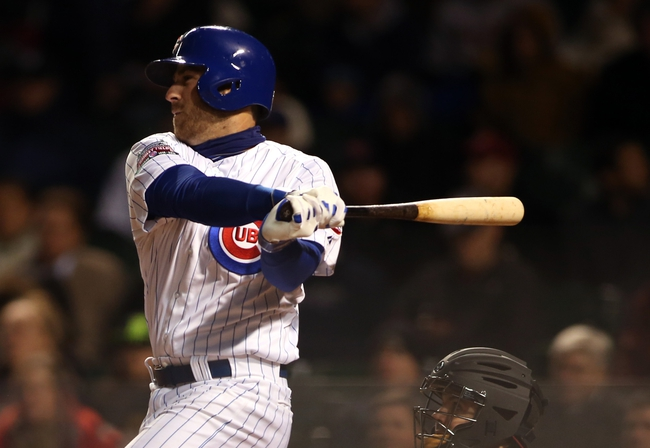 Apr 22, 2014; Chicago, IL, USA; Chicago Cubs third baseman Mike Olt hits a three-run home run against the Arizona Diamondbacks during the fifth inning at Wrigley Field. Mandatory Credit: Jerry Lai-USA TODAY Sports