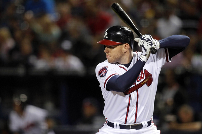 Apr 22, 2014; Atlanta, GA, USA; Atlanta Braves first baseman Freddie Freeman (5) bats against the Miami Marlins in the seventh inning at Turner Field. The Marlins defeated the Braves 1-0. Mandatory Credit: Brett Davis-USA TODAY Sports