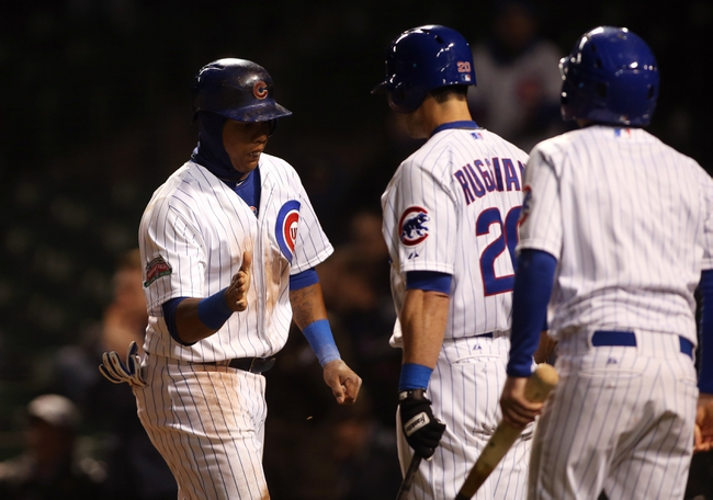 Apr 22, 2014; Chicago, IL, USA; Chicago Cubs shortstop Starlin Castro (left) celebrates with teammate Justin Ruggiano (20) after scoring a run against the Arizona Diamondbacks during the eighth inning at Wrigley Field. Mandatory Credit: Jerry Lai-USA TODAY Sports