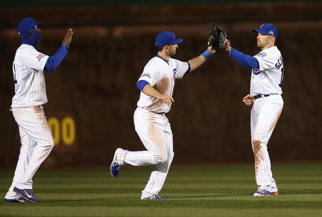 Apr 22, 2014; Chicago, IL, USA; Chicago Cubs players Junior Lake (left) Justin Ruggiano (middle) and Nate Schierholtz celebrate after defeating the Arizona Diamondbacks at Wrigley Field. Mandatory Credit: Jerry Lai-USA TODAY Sports