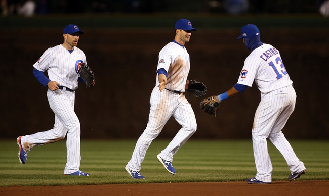 Apr 22, 2014; Chicago, IL, USA; Chicago Cubs players Nate Schierholtz (left) , Justin Ruggiano (middle) and Starlin Castro (13) celebrate after defeating the Arizona Diamondbacks at Wrigley Field. Mandatory Credit: Jerry Lai-USA TODAY Sports