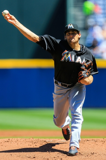 Apr 23, 2014; Atlanta, GA, USA; Miami Marlins starting pitcher Nate Eovaldi (24) pitches in the first inning against the Atlanta Braves at Turner Field. Mandatory Credit: Daniel Shirey-USA TODAY Sports