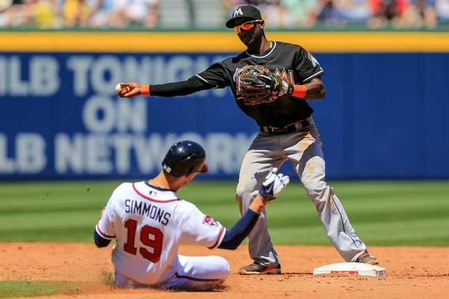 Apr 23, 2014; Atlanta, GA, USA; Miami Marlins shortstop Adeiny Hechavarria (3) turns a double play over Atlanta Braves shortstop Andrelton Simmons (19) in the fifth inning at Turner Field. Mandatory Credit: Daniel Shirey-USA TODAY Sports
