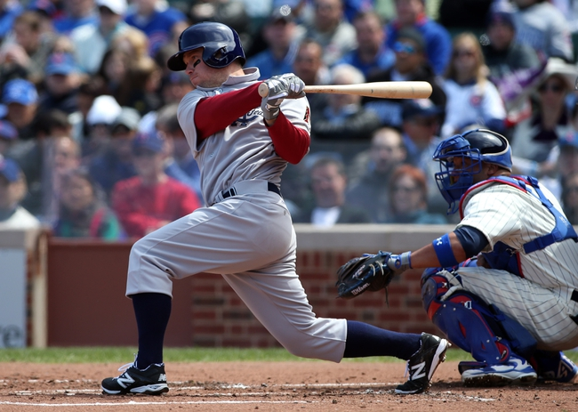Apr 23, 2014; Chicago, IL, USA; Arizona Diamondbacks second baseman Aaron Hill hits a single against the Chicago Cubs during the first inning of a baseball game at Wrigley Field. Mandatory Credit: Jerry Lai-USA TODAY Sports