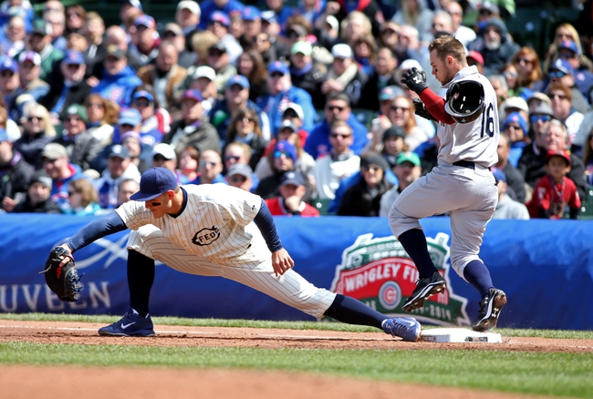 Apr 23, 2014; Chicago, IL, USA; Arizona Diamondbacks shortstop Chris Owings (16) loses his helmet as he beats the throw to Chicago Cubs first baseman Anthony Rizzo (left) to drive in a run on a fielder's choice during the second inning of a baseball game at Wrigley Field. Mandatory Credit: Jerry Lai-USA TODAY Sports