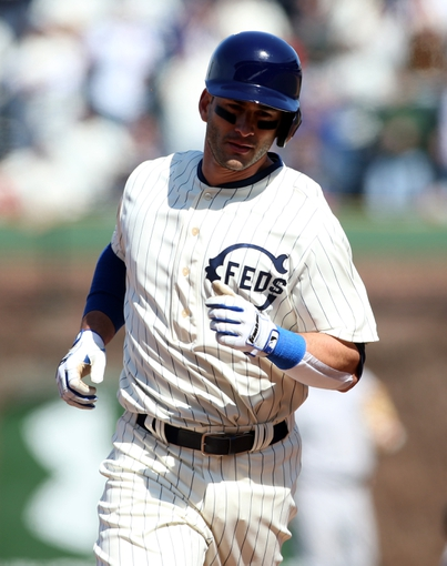 Apr 23, 2014; Chicago, IL, USA; Chicago Cubs outfielder Justin Ruggiano rounds the bases after hitting a two-run home run against the Arizona Diamondbacks during the sixth inning of a baseball game at Wrigley Field. Mandatory Credit: Jerry Lai-USA TODAY Sports
