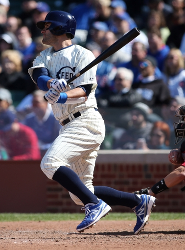 Apr 23, 2014; Chicago, IL, USA; Chicago Cubs outfielder Justin Ruggiano hits a two-run home run against the Arizona Diamondbacks during the sixth inning of a baseball game at Wrigley Field. Mandatory Credit: Jerry Lai-USA TODAY Sports