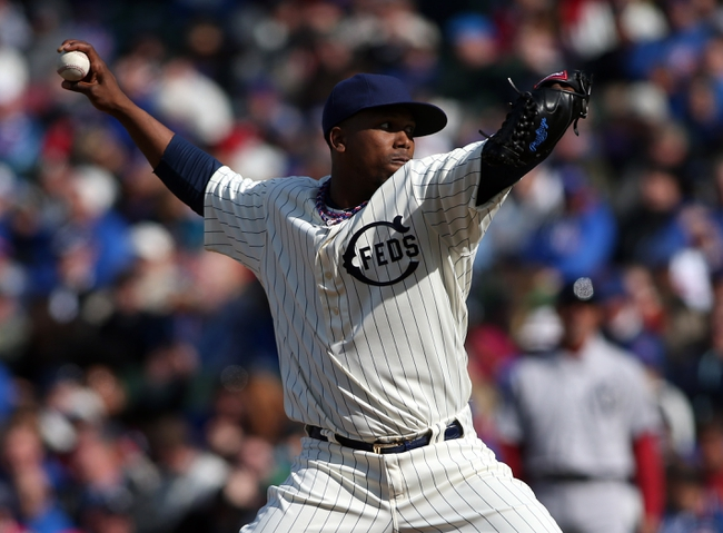 Apr 23, 2014; Chicago, IL, USA; Chicago Cubs relief pitcher Pedro Strop throws a pitch against the Arizona Diamondbacks during the ninth inning of a baseball game at Wrigley Field. Mandatory Credit: Jerry Lai-USA TODAY Sports