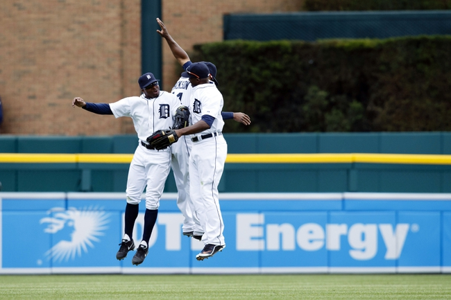 Apr 24, 2014; Detroit, MI, USA; Detroit Tigers left fielder Rajai Davis (left) center fielder Austin Jackson (center) and right fielder Torii Hunter (right) celebrate after the game  against the Chicago White Sox at Comerica Park. Detroit won 7-4. Mandatory Credit: Rick Osentoski-USA TODAY Sports