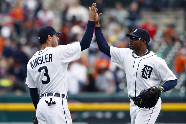 Apr 24, 2014; Detroit, MI, USA; Detroit Tigers second baseman Ian Kinsler (3) and left fielder Rajai Davis (20) high five after the game against the Chicago White Sox at Comerica Park. Detroit won 7-4. Mandatory Credit: Rick Osentoski-USA TODAY Sports