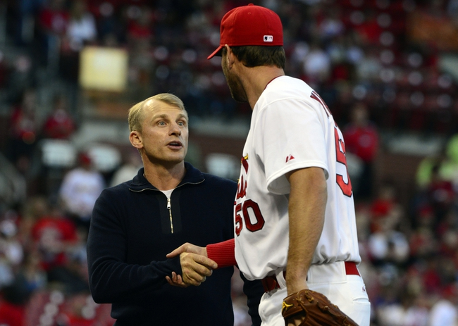Apr 25, 2014; St. Louis, MO, USA; St. Louis Cardinal former player David Eckstein greets starting pitcher Adam Wainwright (50) after throwing out the first pitch prior to a game against the Pittsburgh Pirates at Busch Stadium. Mandatory Credit: Jeff Curry-USA TODAY Sports