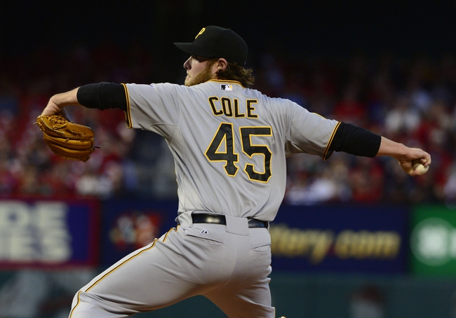 Apr 25, 2014; St. Louis, MO, USA; Pittsburgh Pirates starting pitcher Gerrit Cole (45) throws to a St. Louis Cardinals batter during the first inning at Busch Stadium. Mandatory Credit: Jeff Curry-USA TODAY Sports