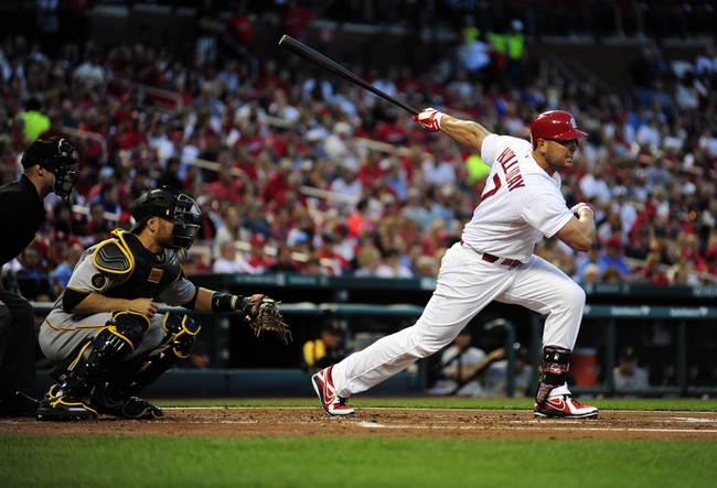 Apr 25, 2014; St. Louis, MO, USA; St. Louis Cardinals left fielder Matt Holliday (7) hits a one run double off of Pittsburgh Pirates starting pitcher Gerrit Cole (not pictured) during the first inning at Busch Stadium. Mandatory Credit: Jeff Curry-USA TODAY Sports