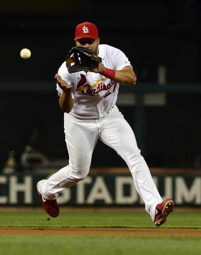Apr 25, 2014; St. Louis, MO, USA; St. Louis Cardinals shortstop Jhonny Peralta (27) fields a ball hit by Pittsburgh Pirates shortstop Clint Barmes (not pictured) during the third inning at Busch Stadium. Mandatory Credit: Jeff Curry-USA TODAY Sports