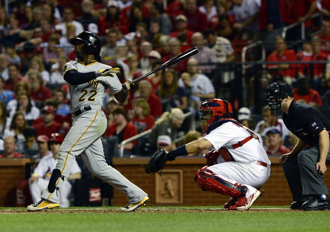 Apr 25, 2014; St. Louis, MO, USA; Pittsburgh Pirates center fielder Andrew McCutchen (22) hits a double off of St. Louis Cardinals starting pitcher Shelby Miller (not pictured) during the sixth inning at Busch Stadium. Mandatory Credit: Jeff Curry-USA TODAY Sports