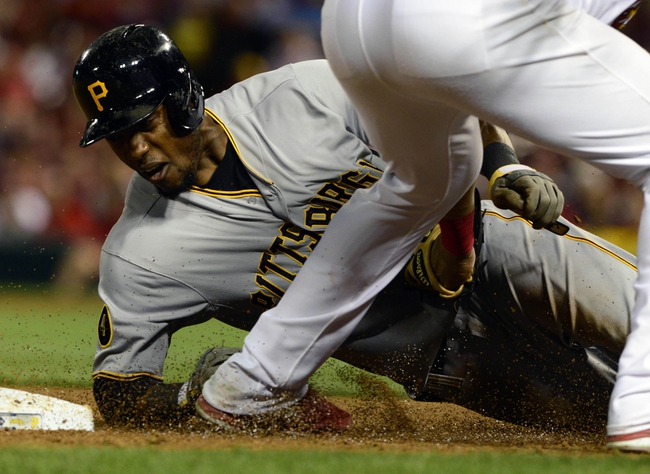 Apr 25, 2014; St. Louis, MO, USA; Pittsburgh Pirates pinch hitter Starling Marte (6) is tagged out at third base by St. Louis Cardinals shortstop Jhonny Peralta (27) after getting caught in a rundown during the eighth inning at Busch Stadium. Mandatory Credit: Jeff Curry-USA TODAY Sports