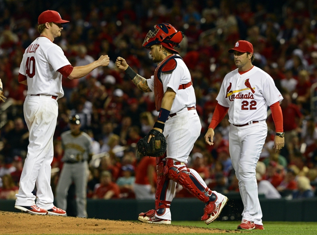 Apr 25, 2014; St. Louis, MO, USA; St. Louis Cardinals starting pitcher Shelby Miller (40) is congratulated by catcher Yadier Molina (4) as manager Mike Matheny (22) walks out to remove him during the sixth inning against the Pittsburgh Pirates at Busch Stadium. St. Louis defeated Pittsburgh 1-0. Mandatory Credit: Jeff Curry-USA TODAY Sports