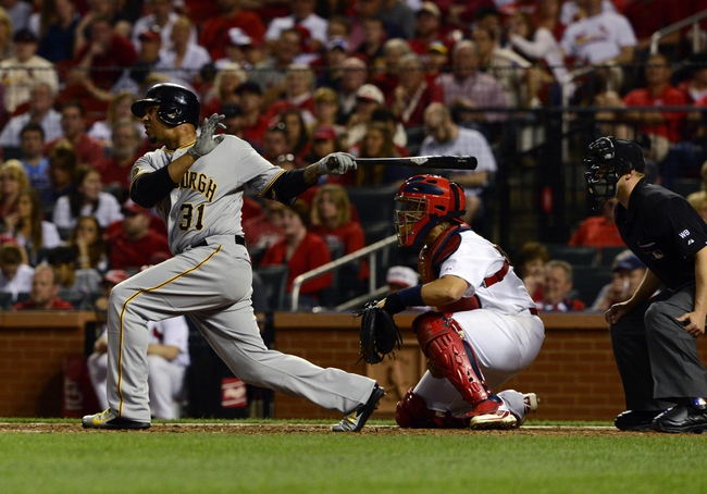 Apr 25, 2014; St. Louis, MO, USA; Pittsburgh Pirates right fielder Jose Tabata (31) hits a single off of St. Louis Cardinals relief pitcher Carlos Martinez (not pictured) during the eighth inning at Busch Stadium. St. Louis defeated Pittsburgh 1-0. Mandatory Credit: Jeff Curry-USA TODAY Sports