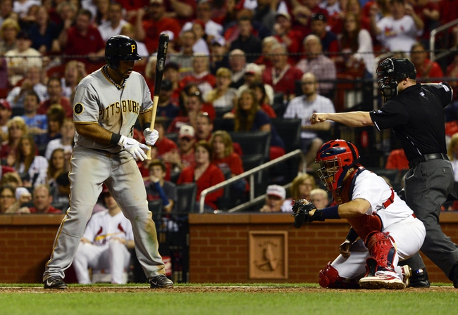 Apr 25, 2014; St. Louis, MO, USA; Pittsburgh Pirates third baseman Pedro Alvarez (24) is called out on strikes with the bases loaded by umpire Will Little (93) during the eighth inning against the St. Louis Cardinals at Busch Stadium. St. Louis defeated Pittsburgh 1-0. Mandatory Credit: Jeff Curry-USA TODAY Sports