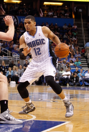 Apr 9, 2014; Orlando, FL, USA; Orlando Magic forward Tobias Harris (12) drives to the basket against the Brooklyn Nets during the second half at Amway Center. Orlando Magic defeated the Brooklyn Nets 115-111. Mandatory Credit: Kim Klement-USA TODAY Sports