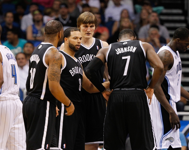 Apr 9, 2014; Orlando, FL, USA; Brooklyn Nets guard Deron Williams (8) huddles up with teammates against the Orlando Magic during the second half at Amway Center. Orlando Magic defeated the Brooklyn Nets 115-111. Mandatory Credit: Kim Klement-USA TODAY Sports