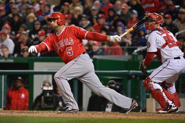 Apr 23, 2014; Washington, DC, USA; Los Angeles Angels first baseman Albert Pujols (5) hits a rbi double during the sixth inning against the Washington Nationals at Nationals Park. Washington Nationals defeated Los Angeles Angels 5-4. Mandatory Credit: Tommy Gilligan-USA TODAY Sports