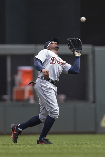 Apr 26, 2014; Minneapolis, MN, USA; Detroit Tigers left fielder Rajai Davis (20) catches a fly ball in the second inning against the Minnesota Twins at Target Field. Mandatory Credit: Jesse Johnson-USA TODAY Sports