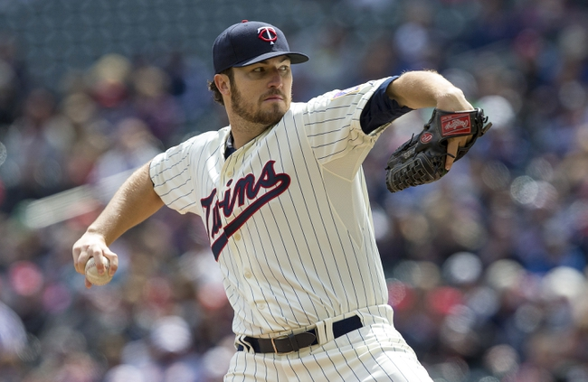 Apr 26, 2014; Minneapolis, MN, USA; Minnesota Twins starting pitcher Phil Hughes (45) delivers a pitch in the first inning against the Detroit Tigers at Target Field. Mandatory Credit: Jesse Johnson-USA TODAY Sports