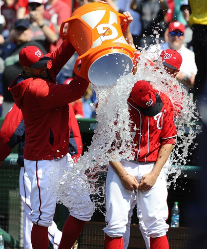 Apr 26, 2014; Washington, DC, USA; Washington Nationals starting pitcher Tanner Roark (57) is doused by  relief pitcher Craig Stammen and relief pitcher Aaron Barrett after their game against the San Diego Padres at Nationals Park. The Nationals won 4-0. Mandatory Credit: Brad Mills-USA TODAY Sports