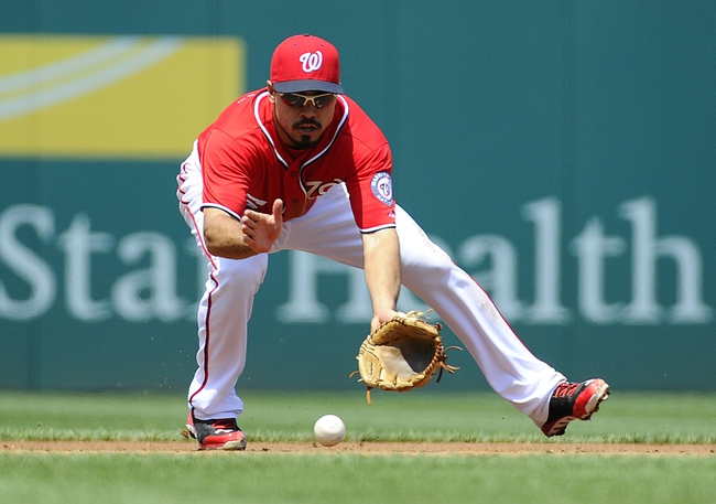 Apr 26, 2014; Washington, DC, USA; Washington Nationals third baseman Anthony Rendon (6) fields a ground ball against the San Diego Padres  during the second inning at Nationals Park. Mandatory Credit: Brad Mills-USA TODAY Sports