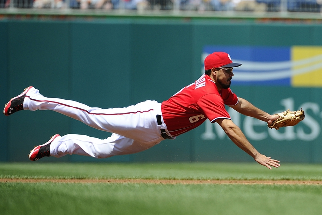 Apr 26, 2014; Washington, DC, USA; Washington Nationals third baseman Anthony Rendon (6) makes a diving stop against the San Diego Padres  during the second inning at Nationals Park. Mandatory Credit: Brad Mills-USA TODAY Sports