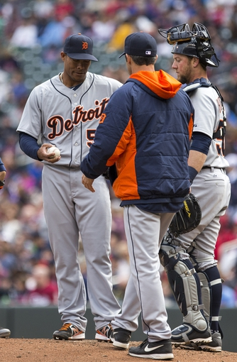 Apr 26, 2014; Minneapolis, MN, USA; Detroit Tigers relief pitcher Jose Ortega (56) gets pulled from the game by manager Brad Ausmus in the fifth inning at Target Field. Mandatory Credit: Jesse Johnson-USA TODAY Sports