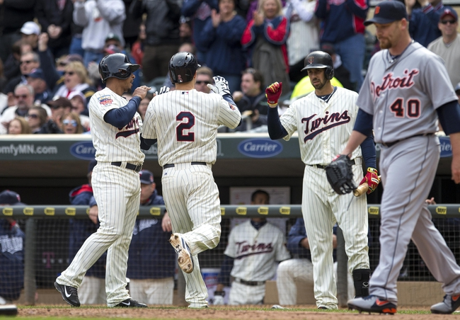 Apr 26, 2014; Minneapolis, MN, USA; Minnesota Twins second baseman Brian Dozier (2) celebrates with shortstop Eduardo Escobar (5) and first baseman Chris Colabello (20) after scoring a run in the fifth inning against the Detroit Tigers at Target Field. Mandatory Credit: Jesse Johnson-USA TODAY Sports