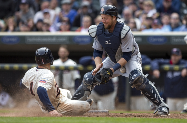 Apr 26, 2014; Minneapolis, MN, USA; Minnesota Twins right fielder Sam Fuld (1) slides into home plate safely before Detroit Tigers catcher Bryan Holaday (50) can make a tag in the fifth inning at Target Field. Mandatory Credit: Jesse Johnson-USA TODAY Sports
