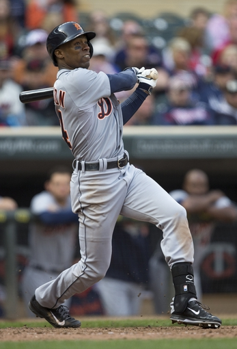 Apr 26, 2014; Minneapolis, MN, USA; Detroit Tigers center fielder Austin Jackson (14) hits a double in the ninth inning against the Minnesota Twins at Target Field. The Twins won 5-3. Mandatory Credit: Jesse Johnson-USA TODAY Sports