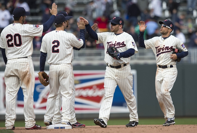 Apr 26, 2014; Minneapolis, MN, USA; Minnesota Twins left fielder Jason Kubel (13) celebrates with second baseman Brian Dozier (2) after beating the Detroit Tigers at Target Field. The Twins won 5-3. Mandatory Credit: Jesse Johnson-USA TODAY Sports