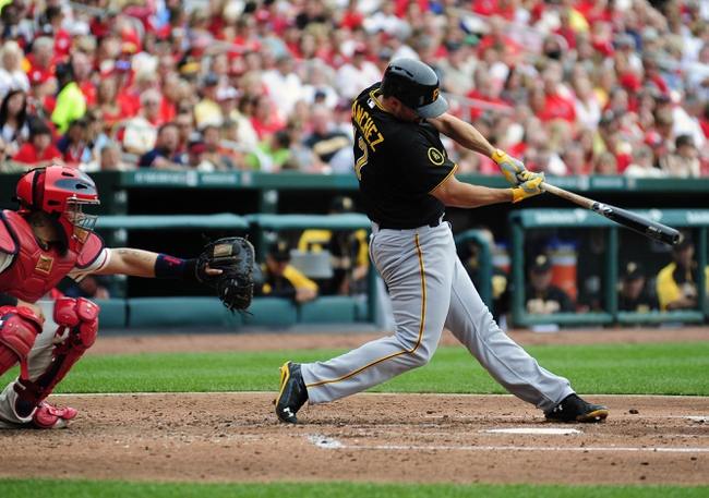 Apr 26, 2014; St. Louis, MO, USA; Pittsburgh Pirates first baseman Gaby Sanchez (17) hits a two run double off of St. Louis Cardinals starting pitcher Tyler Lyons (not pictured) during the fourth inning at Busch Stadium. Mandatory Credit: Jeff Curry-USA TODAY Sports
