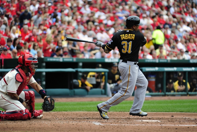 Apr 26, 2014; St. Louis, MO, USA; Pittsburgh Pirates right fielder Jose Tabata (31) hits a single run off of St. Louis Cardinals starting pitcher Tyler Lyons (not pictured) during the fourth inning at Busch Stadium. Mandatory Credit: Jeff Curry-USA TODAY Sports