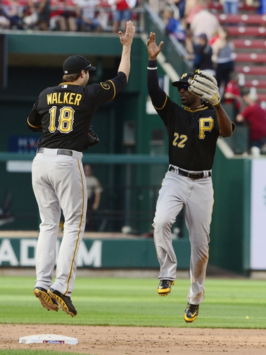 Apr 26, 2014; St. Louis, MO, USA; Pittsburgh Pirates center fielder Andrew McCutchen (22) celebrates with second baseman Neil Walker (18) after defeating the St. Louis Cardinals 6-1 at Busch Stadium. Mandatory Credit: Jeff Curry-USA TODAY Sports