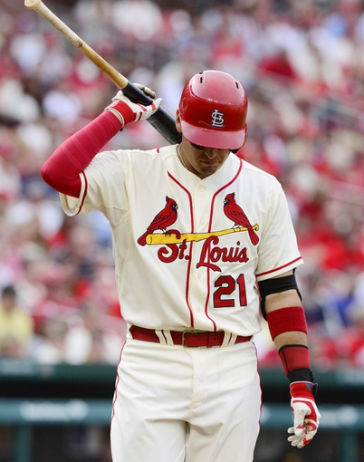 Apr 26, 2014; St. Louis, MO, USA; St. Louis Cardinals first baseman Allen Craig (21) reacts after striking out during the eighth inning against the Pittsburgh Pirates at Busch Stadium. Pittsburgh defeated St. Louis 6-1. Mandatory Credit: Jeff Curry-USA TODAY Sports