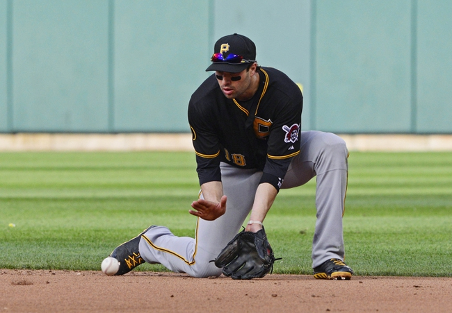 Apr 26, 2014; St. Louis, MO, USA; Pittsburgh Pirates second baseman Neil Walker (18) fields a ground ball hit by St. Louis Cardinals third baseman Matt Carpenter (not pictured) during the ninth inning at Busch Stadium. Pittsburgh defeated St. Louis 6-1. Mandatory Credit: Jeff Curry-USA TODAY Sports